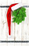 Vintage style christmas decoration. Red Santa Claus hat Royalty Free Stock Photography