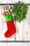 Vintage style christmas decoration. Red Santas hat, Teddy Bear Stock Image