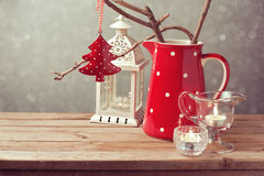 Vintage style Christmas table decoration over blur background Royalty Free Stock Image