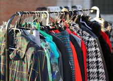 Vintage style clothes  for sale at  flea market Stock Images
