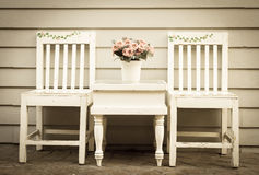 Vintage style color of chair and table with flowers vase. Stock Photography