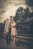 Vintage style couple. Beautiful vintage style couple with suitcases on  train station platform Stock Photography