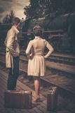 Vintage style couple. Beautiful vintage style couple with suitcases on  train station platform Royalty Free Stock Photos