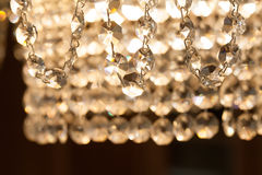 Vintage style crystal chandelier lamp with hanging pendants. macro view. Soft focus Stock Images