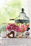 Vintage style decoration with flowers and bird cages Stock Photography