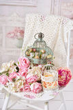 Vintage style decoration with flowers in old bird cages Royalty Free Stock Image