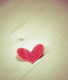 Vintage style of decorative red heart on wood background, concept of valentine day Royalty Free Stock Photo