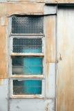 Vintage style door and glass window in Tai o fishing village, HongKong Royalty Free Stock Image