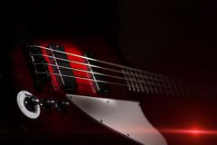Vintage style electric bass on black background.  royalty free stock photography