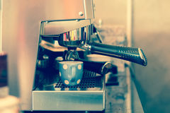 Vintage style Espresso being drawn out of a professional coffee Royalty Free Stock Images