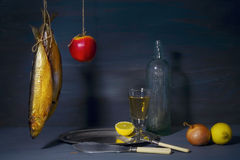 Vintage style food still life with smoked fish kipper wine and Royalty Free Stock Photos