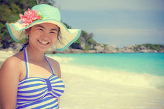 Vintage style girl on the beach at Thailand Royalty Free Stock Image