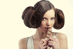 Vintage style girl eating chocolate Stock Photo