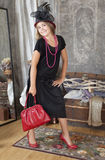 Vintage style girl with red handbag Royalty Free Stock Photo