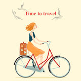 Vintage style girl riding a bicycle Royalty Free Stock Image