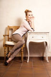 Vintage style. Girl sitting at the retro desk. Royalty Free Stock Image