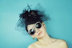 Vintage Style Girl Wearing Old fashioned Hat. Retro Woman Portrait. Vintage Style Girl Wearing Old fashioned Hat, Beautiful black hat with feathers. Romantic Royalty Free Stock Photo