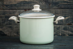 Vintage Style Green Enamel Saucepan on Blue Wooden Background Stock Photos