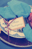 Vintage style Happy Thanksgiving dining table place setting with retro filter - closeup. Stock Photography