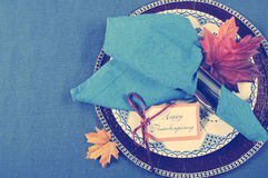Vintage style Happy Thanksgiving dining table place setting with retro filter Stock Photography