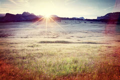 Vintage style image of Alpe di Siusi sunrise. Dolomites Alps, Italy Royalty Free Stock Photography