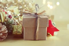 Vintage style image of Christmas gift and decorations. With bokeh lights background Royalty Free Stock Image