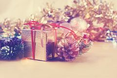 Vintage style image of Christmas gift and decorations. Vintage style image of gold Christmas gift and decorations with retro effect Stock Photos