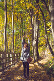 Vintage style image of young adult woman in Autumn Stock Photos