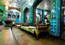 Vintage style interior of traditional persian restaurant with old ottoman couches Royalty Free Stock Images