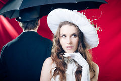 Vintage style lady in white hat and man in black Stock Photography