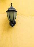 Vintage style lamp. On rustic yellow wall Stock Photo