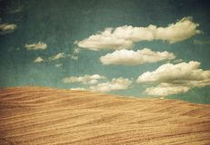 Vintage style landscape, clouds over the hills.  Royalty Free Stock Photo