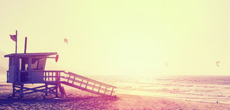 Vintage style lifeguard tower at sunset in Malibu. Stock Photography