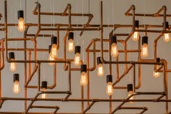 Vintage style light bulbs. Hang and decorated with alloy pipes in a living room Stock Photo