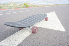 Vintage Style Longboard Black Skateboard Royalty Free Stock Photo