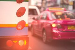 Free Vintage Style Of Rear Lamp Signal Of Old Bus On Traffic Backgruond With Sun Flare In The Morning Stock Photography - 164512612