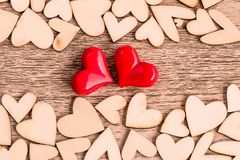 Free Vintage Style Of Two Red Hearts With Wooden Hearts On A Wooden Stock Images - 112172944