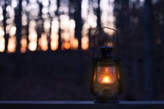 Vintage style lamp with a candle at night stock photos