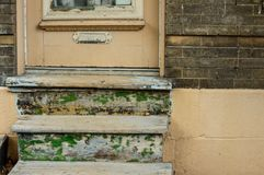 Front door with mail slot old fashioned wood door worth peeling paint on steps Stock Images