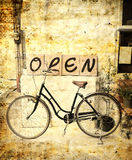 Vintage style : open sign and bicycle Stock Image