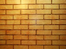 Vintage style orange tone brick wall detailed pattern textured background: brickwork masonry detail stock image