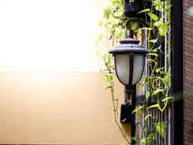 Vintage style outside lamp wih the yellow wall Stock Photo
