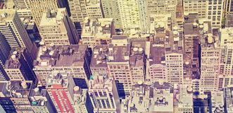 Vintage style panoramic view of Manhattan roofs. Stock Photo