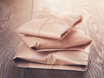 Vintage style parcels wrapped with rope. Toned photo royalty free stock image