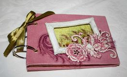 Vintage-style photo album with pockets. Handmade by photographer Stock Images
