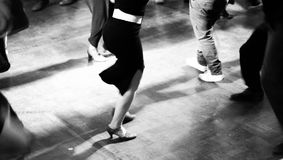 Vintage style photo of dance hall with people dancing. Bottom view royalty free stock photos