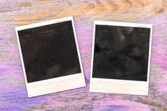 Vintage style photo frames over rustic wooden background Royalty Free Stock Photo