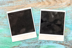 Vintage style photo frames on rustic wooden background Stock Photography