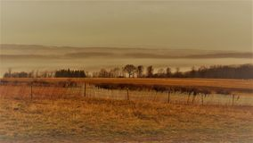 Free Vintage Style Photo Of Rustic Wood Snow Fence And Fog On The Hillside Stock Photos - 85392543