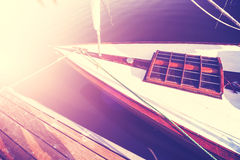 Vintage style photo of a sailing boat at sunset. Stock Photo